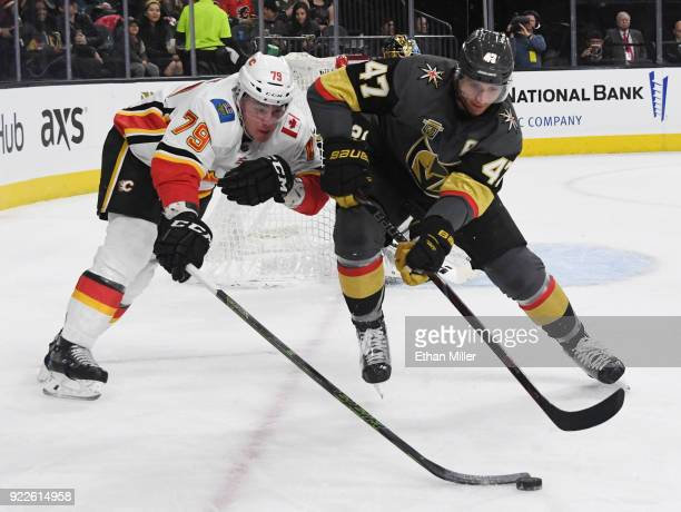 Micheal Ferland of the Calgary Flames and Luca Sbisa of the Vegas Golden Knights go after a loose puck in the first period of their game at TMobile...