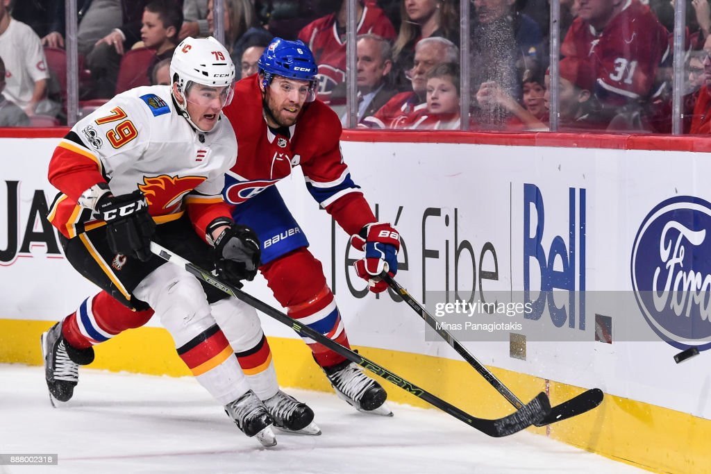 Micheal Ferland #79 of the Calgary Flames and Shea Weber #6 of the Montreal Canadiens chase the puck around the boards during the NHL game at the Bell Centre on December 7, 2017 in Montreal, Quebec, Canada. The Calgary Flames defeated the Montreal Canadiens 3-2 in overtime.