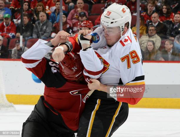 Micheal Ferland of the Calgary Flames and Zac Rinaldo of the Arizona Coyotes scuffle during the first period at Gila River Arena on February 22, 2018...