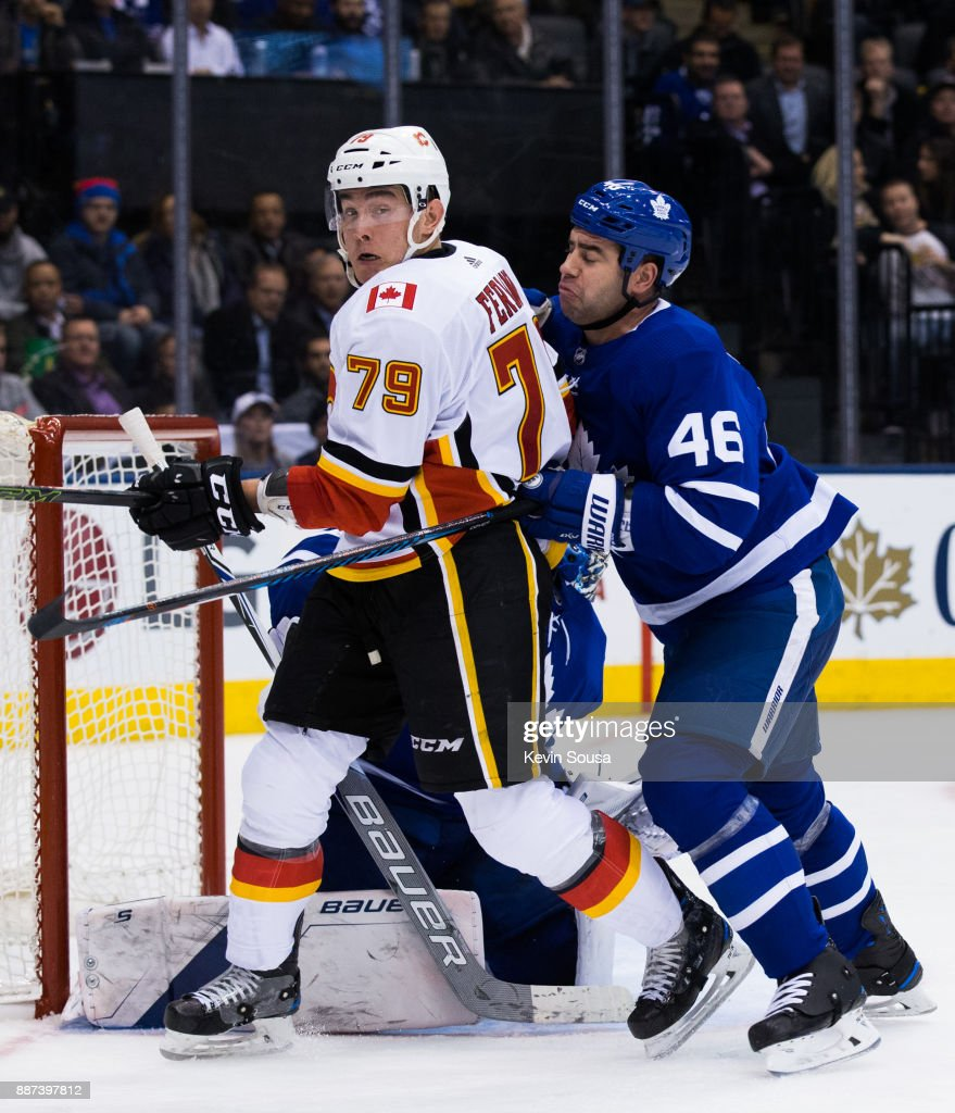 Micheal Ferland #79 of the Calgary Flames battles with Roman Polak #46 of the Toronto Maple Leafs during the third period at the Air Canada Centre on December 6, 2017 in Toronto, Ontario, Canada.