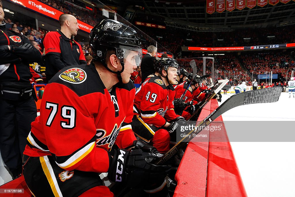 Micheal Ferland #79 of the Calgary Flames sits on the bench during an NHL game against the Vancouver Canucks on April 7, 2016 at the Scotiabank Saddledome in Calgary, Alberta, Canada.