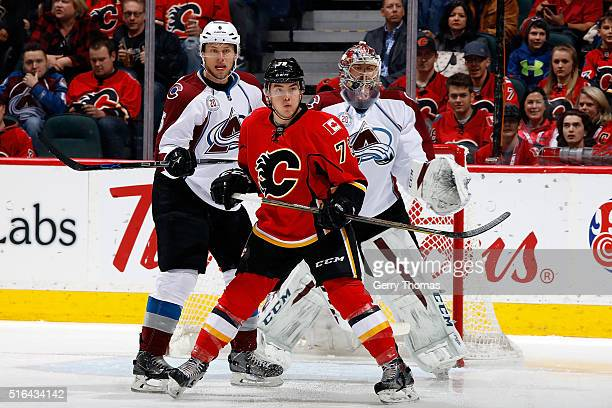 Micheal Ferland of the Calgary Flames skates against Erik Johnson of the Colorado Avalanche during an NHL game at Scotiabank Saddledome on March 18,...