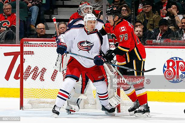 Micheal Ferland of the Calgary Flames skates against Jack Johnson of the Columbus Blue Jackets during an NHL game on December 16, 2016 at the...