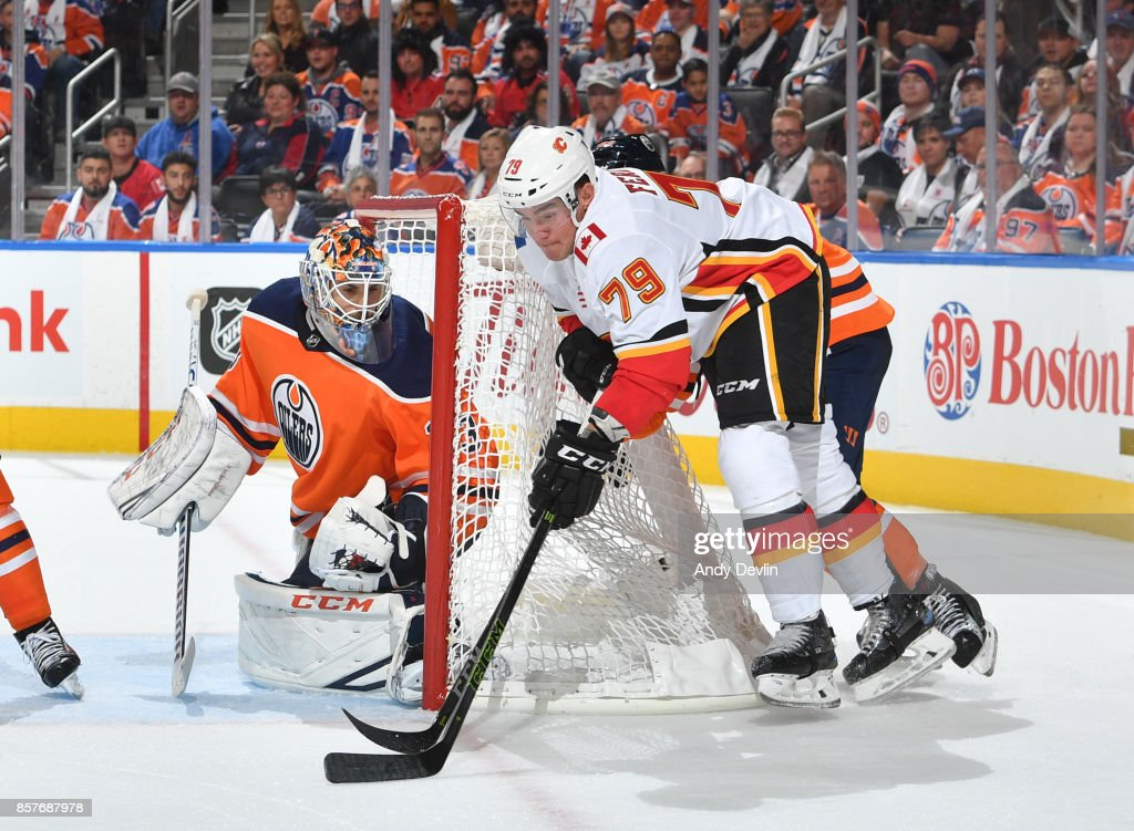 Micheal Ferland #79 of the Calgary Flames takes a shot on Cam Talbot #33 of the Edmonton Oilers on October 4, 2017 at Rogers Place in Edmonton, Alberta, Canada.