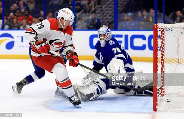Micheal Ferland of the Carolina Hurricanes scores on Louis Domingue of the Tampa Bay Lightning during a game at Amalie Arena on October 16 2018 in...