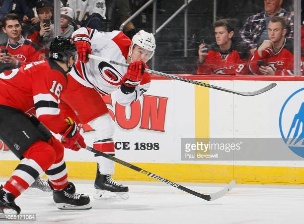 Micheal Ferland of the Carolina Hurricanes shoots as Steven Santini of the New Jersey Devils moves in during an NHL hockey game on December 29 2018...