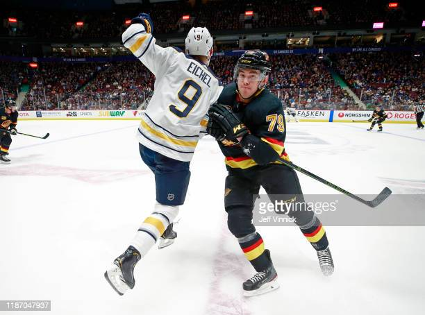 Micheal Ferland of the Vancouver Canucks checks Jack Eichel of the Buffalo Sabres during their NHL game at Rogers Arena December 7, 2019 in...