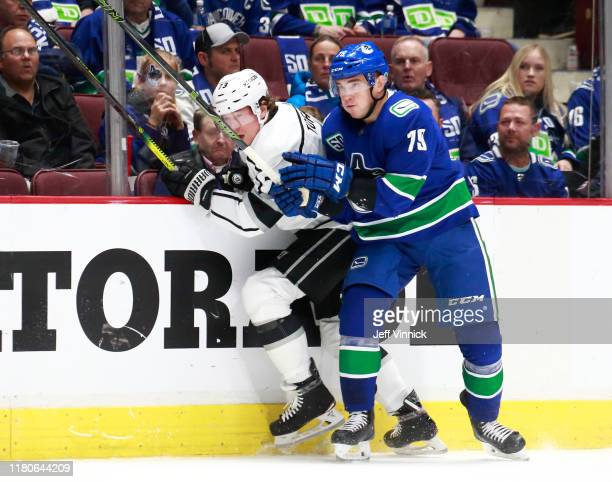 Micheal Ferland of the Vancouver Canucks checks Tyler Toffoli of the Los Angeles Kings during their NHL game at Rogers Arena October 9, 2019 in...