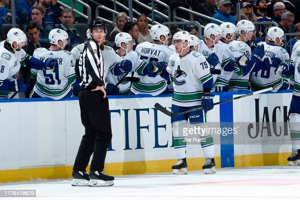 Micheal Ferland of the Vancouver Canucks is congratulated by teammates after scoring a goal against the St. Louis Blues at Enterprise Center on...