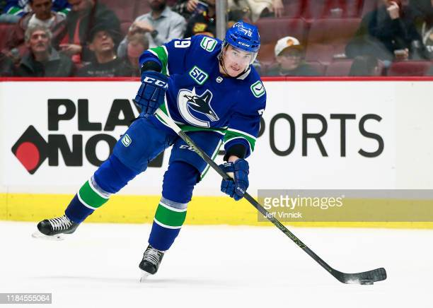 Micheal Ferland of the Vancouver Canucks skates up ice with the puck during their NHL game against the Florida Panthers at Rogers Arena October 28,...