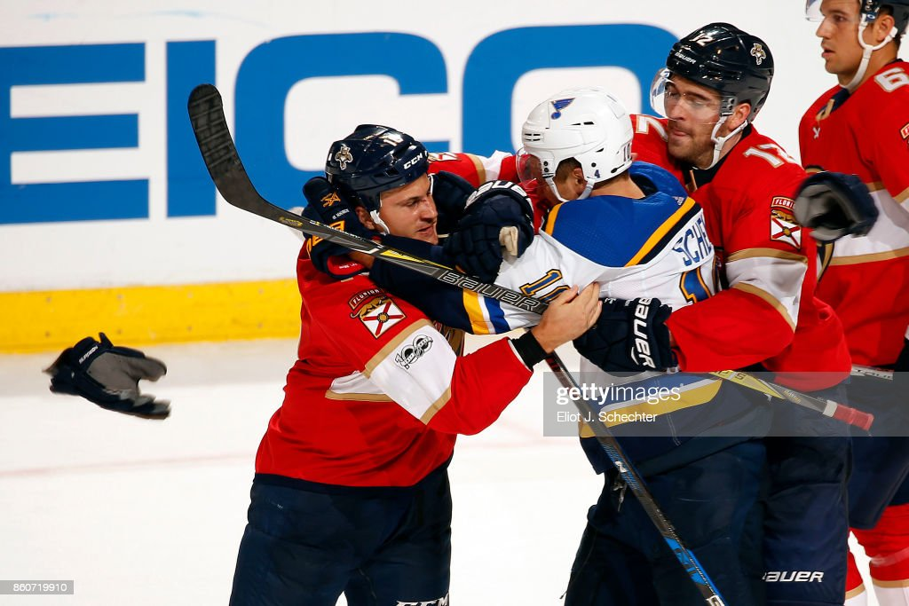 Micheal Haley #18 of the Florida Panthers fights with Brayden Schenn #10 of the St. Louis Blues in the third period at the BB&T Center on October 12, 2017 in Sunrise, Florida.