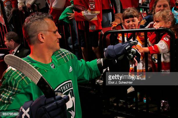 Micheal Haley of the Florida Panthers is greeted by fans on his way out to the ice for warm ups prior to the start of the game against the Edmonton...