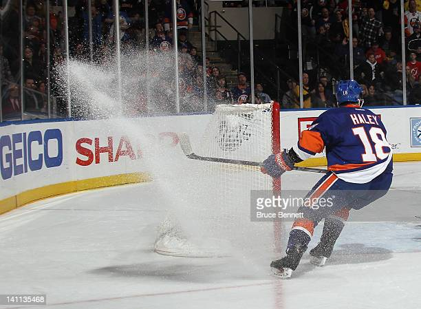 Micheal Haley of the New York Islanders skates against the New Jersey Devils at the Nassau Veterans Memorial Coliseum on March 10 2012 in Uniondale...