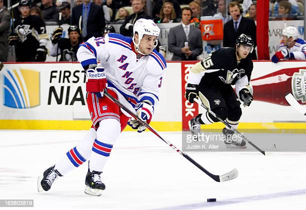 Micheal Haley of the New York Rangers handles the puck against the Pittsburgh Penguins during the game at Consol Energy Center on March 16 2013 in...