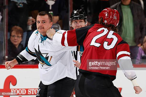 Micheal Haley of the San Jose Sharks fights with Ryan White of the Arizona Coyotes during the first period of the NHL game at Gila River Arena on...