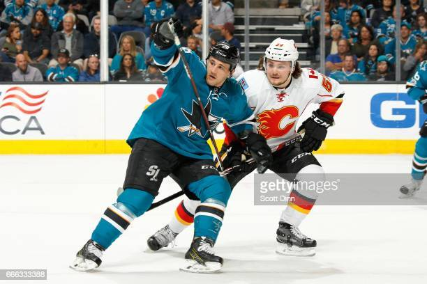 Micheal Haley of the San Jose Sharks skates against Rasmus Andersson of the Calgary Flames at SAP Center at San Jose on April 8 2017 in San Jose...