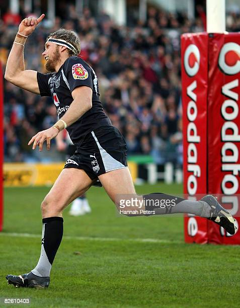 Micheal Luck of the Warriors celebrates after scoring a try during the round 25 NRL match between the Warriors and the Penrith Panthers at Mt Smart...