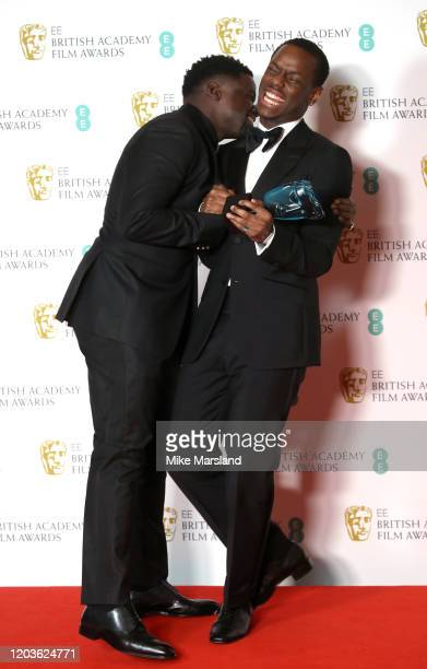 Micheal Ward with the EE Rising Star Award poses with Daniel Kaluuya in the Winners Room during the EE British Academy Film Awards 2020 at Royal...