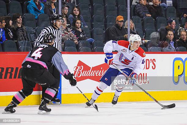 Micheal Zipp of the Calgary Hitmen defends against Adam Helewka of the Spokane Chiefs during a WHL game at Scotiabank Saddledome on October 29, 2015...