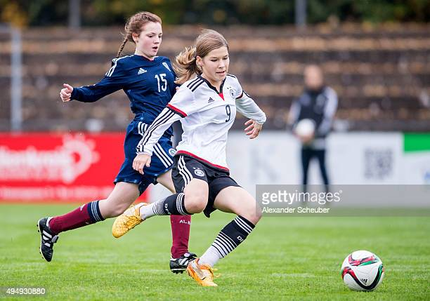Micheala McAlonie of Scotland challenges Pauline Berning of Germany during the international friendly match between U15 Girl's Germany and U15 Girl's...