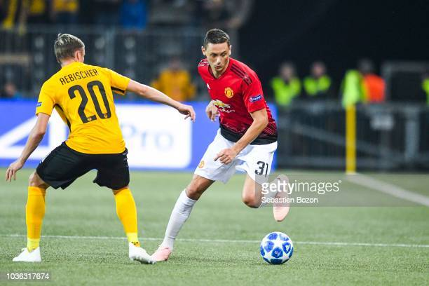 Michel Aebischer of Bern and Nemanja Matic of Manchester during the Champions League match between Young Boys Berne and Manchester United at Stade de...