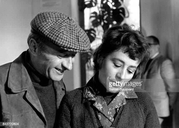 Michel Audiard and Annie Girardot on the set of Elle boit pas elle fume pas elle drague pasmais elle cause directed by Michel Audiard