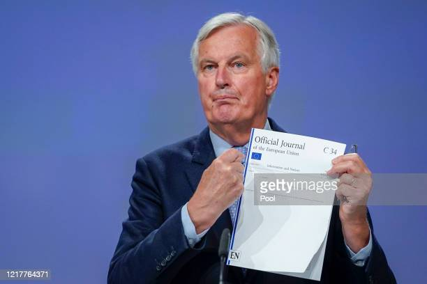 Michel Barnier, Chief Negotiator for Europe, holds the Official Journal of the European Union C34 during a press conference regarding the fourth...