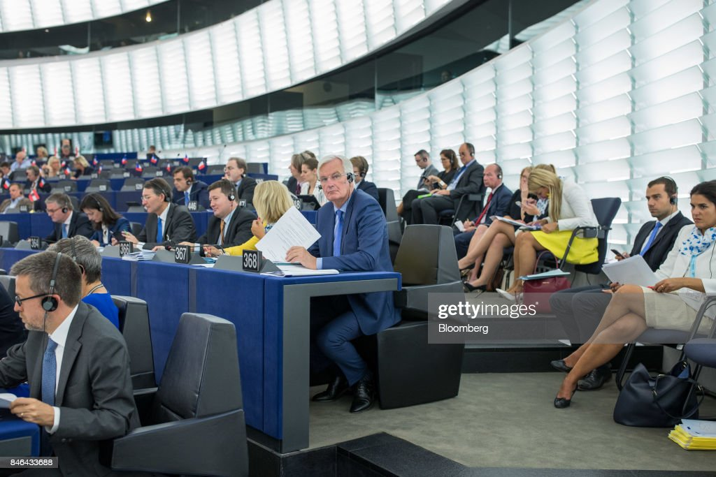 Michel Barnier, chief negotiator for the European Union (EU), center, attends the State of the Union speech at the European Parliament in Strasbourg, France, on Wednesday, Sept. 13, 2017. In a sign of the EUs renewed confidence, European Commission President Jean-Claude Juncker will push for free-trade pacts withAustralia and New Zealandat a time when the U.S. is turning inward, along with a bloc-wide system for screening foreign takeovers and deeper euro-area banking integration. Photographer: Jasper Juinen/Bloomberg via Getty Images