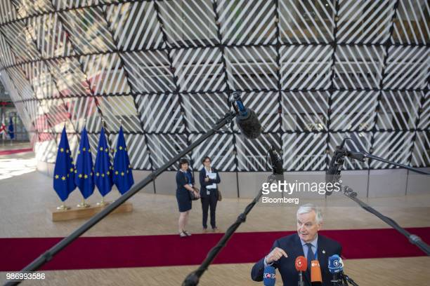 Michel Barnier chief negotiator for the European Union gestures while speaking to the media as he arrives for a EU leaders summit in Brussels Belgium...