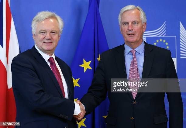 Michel Barnier chief negotiator for the European Union meets Secretary of State for Exiting the European Union David Davis ahead of the start of...