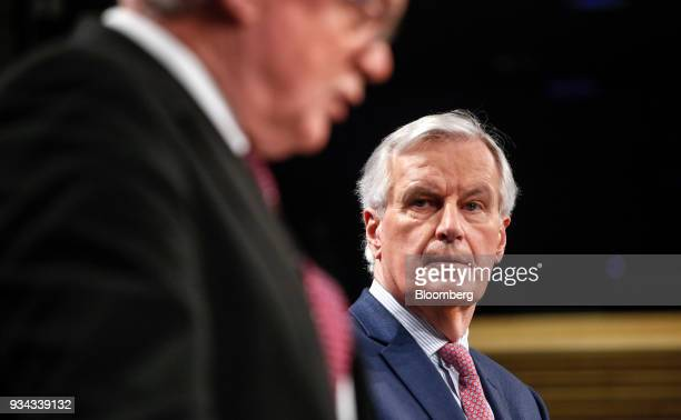 Michel Barnier chief negotiator for the European Union right listens as David Davis UK exiting the European Union secretary speaks during a news...