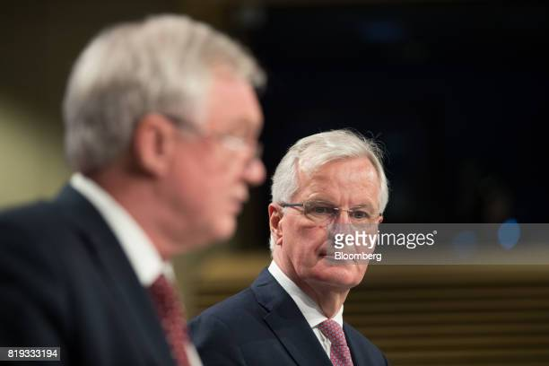 Michel Barnier chief negotiator for the European Union right looks on as he stands beside David Davis UK exiting the European Union secretary during...