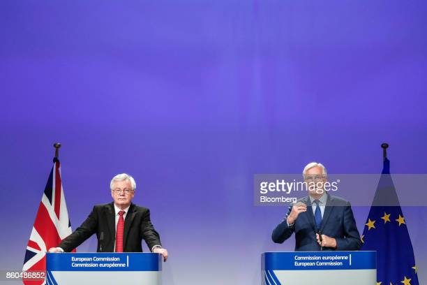 Michel Barnier chief negotiator for the European Union right speaks as David Davis UK exiting the European Union secretary looks on during a news...