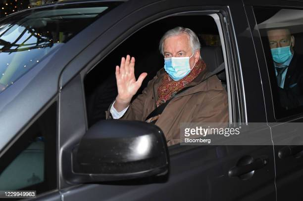 Michel Barnier, European Union chief negotiator, waves from a car as he leaves his hotel ahead of Brexit talks in London, U.K., on Saturday, Dec. 5,...