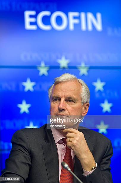 Michel Barnier financial services commissioner for the European Union pauses at a news conference following a European Union finance ministers...