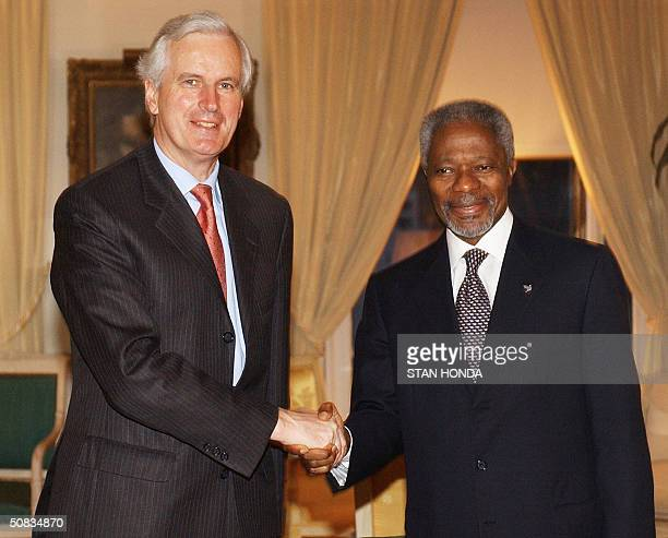 Michel Barnier France's Foreign Minister shakes hands with United Nations Secretary General Kofi Annan before their dinner meeting 13 May at the...