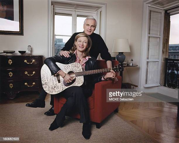 Michel Barnier sitting with his wife Isabelle playing guitar in the living room of their apartment on the Foreign Ministry in PARIS