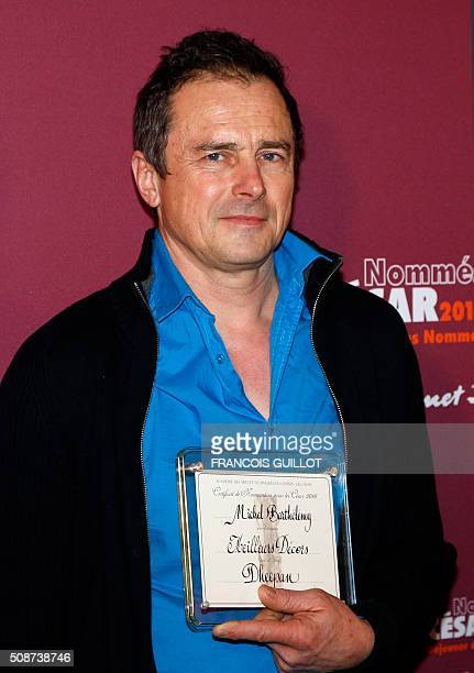 Michel Barthelemy poses with his nomination certificate for Best Set Design during the nominations event for the 2016 César film awards on February 6...
