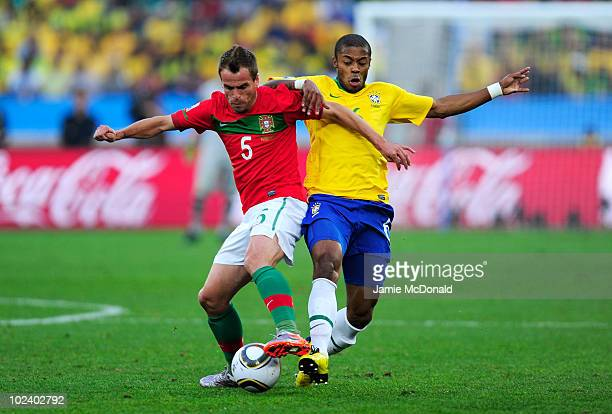 Michel Bastos of Brazil and Duda of Portugal tussle for the ball during the 2010 FIFA World Cup South Africa Group G match between Portugal and...