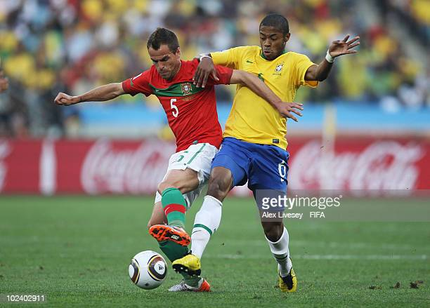 Michel Bastos of Brazil challenges Duda of Portugal during the 2010 FIFA World Cup South Africa Group G match between Portugal and Brazil at Durban...