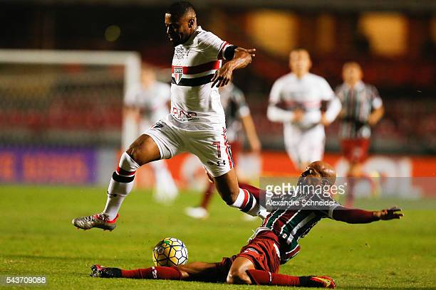Michel Bastos of Sao Paulo and Wellington Silva of Fluminense in action during the match between Sao Paulo and Fluminense for the Brazilian Series A...