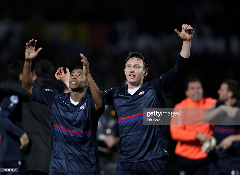 Michel Bastros and Kim Kallstrom of Olympique Lyonnais celebrate going through to the Semi-Finals after the UEFA Champions League quarter final second leg match between Bordeaux and Olympique Lyonnais at Stade Chaban-Delmas on April 7, 2010 in Bordeaux, France.