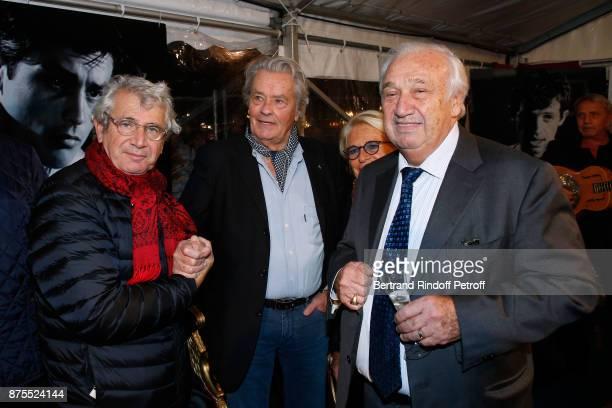 Michel Boujenah Alain Delon and Marcel Campion attend La Grande Roue de Paris Opening Ceremony at Place de la Condorde on the Champs Elysees on...
