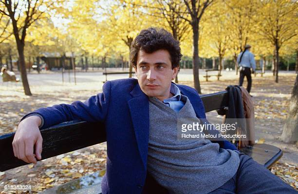 Michel Boujenah relaxes in a Paris park. Boujenah is a popular comedian and actor.