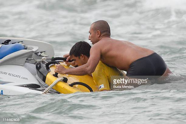 Michel Bourez is rescued after falling during Round 5 of the Billabong Rio Pro at Arpoador Beach on May 20 2011 in Rio de Janeiro Brazil