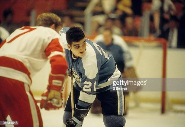 Michel Briere of the Pittsburgh Penguins takes the faceoff against Garry Unger of the Detroit Red Wings during an NHL game circa 196970 at the...
