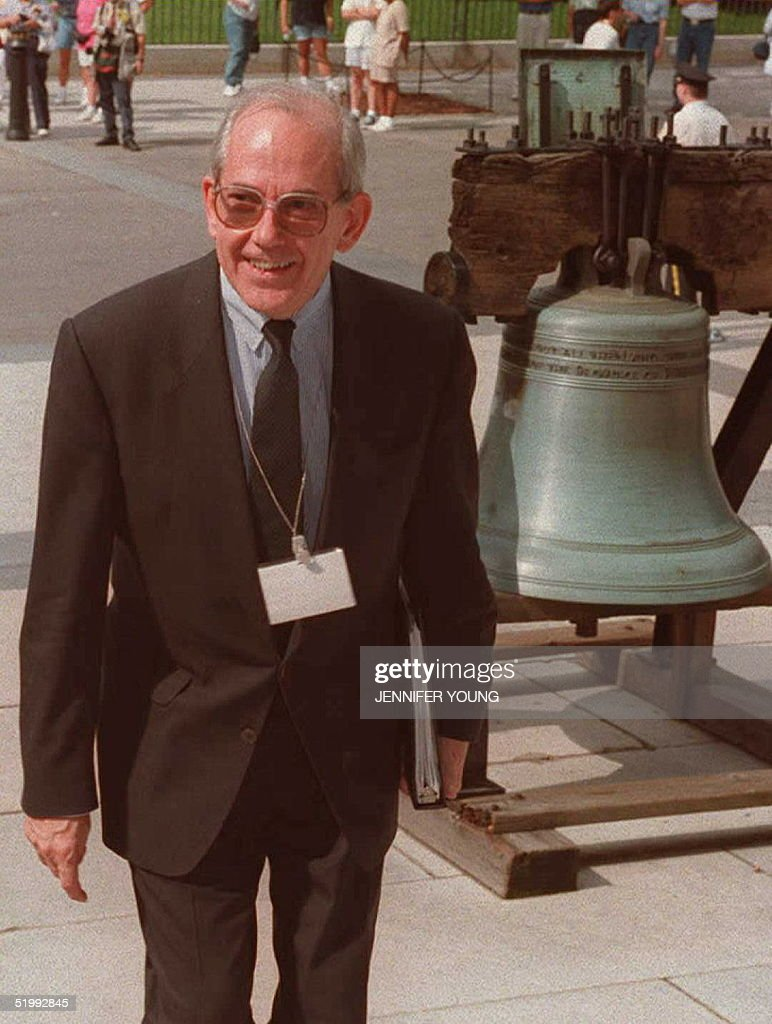 Michel Camdessus, managing director of the International Monetary Fund (IMF), walks past a replica of the Liberty Bell arrives at the US department of Treasury 07 October for a meeting of the Group of Seven (G7) finance leaders. The day-long meeting brought together finance ministers and central bank governors of Britain, Canada, France, Germany, Italy, Japan and the US.