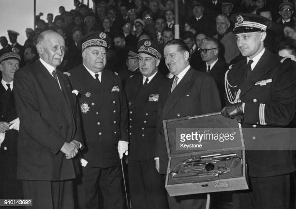 Michel Clemenceau son of the late French Prime Minister Georges Clemenceau hands over his father's duelling pistols to Alain Poher the French...