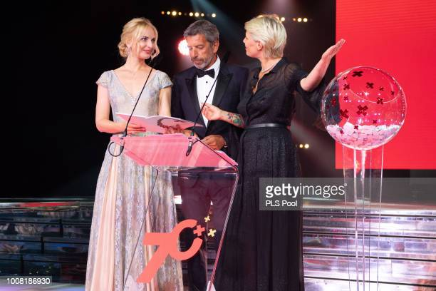 Michel Cymes and Maitena Biraben speak on stage during the 70th Monaco Red Cross Ball Gala on July 27 2018 in MonteCarlo Monaco