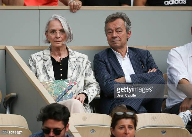 Michel Denisot and his wife Martine Patier attend the victory of Rafael Nadal of Spain during day 10 of the 2019 French Open at Roland Garros stadium...